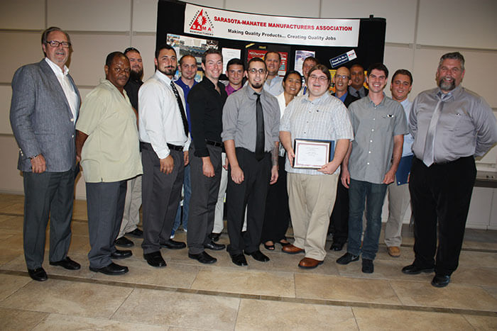 Peter D. Straw, SAMA Executive Director and Precision Machining Instructor Ed Doherty congratulate 16 graduates. All 16 already have jobs in local manufacturing.