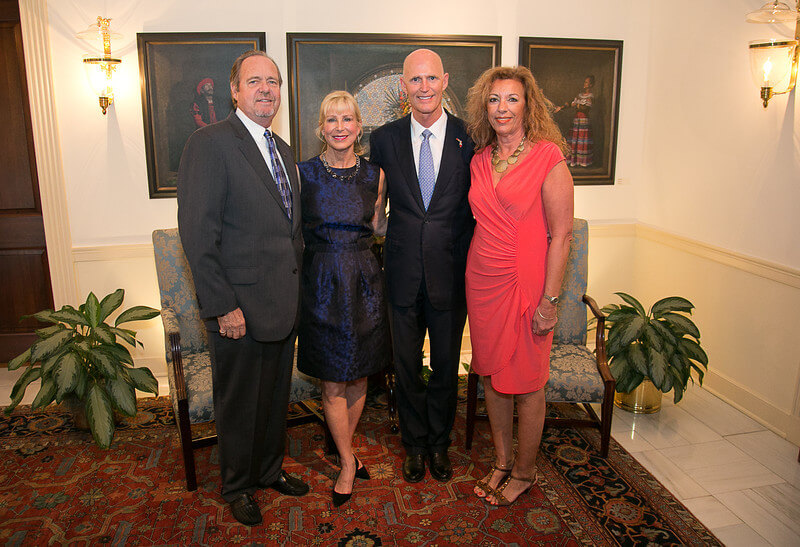 Peter D. Straw, Executive Director of SAMA is greeted by Governor Rick Scott at the Community Leadership Reception and Dinner held at the Governor's Mansion Oct. 21, 2013. A group of 24 community leaders shared ideas over dinner with the Governor. Accompanying Mr. Straw are Barbara Page and Florida First Lady, Ann Scott.